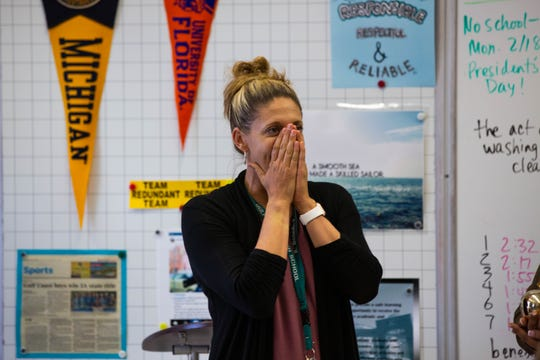 English teacher Kim Benedict reacts to the surprise of receiving a Golden Apple award at Gulf Coast High School in North Naples on Wednesday, Feb. 13, 2019. The awards, which highlight best practices in teaching, were given to seven teachers in Collier County.