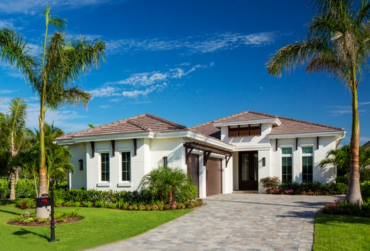 Divco's Senza model is located on a lakefront homesite in Miromar Lakes.