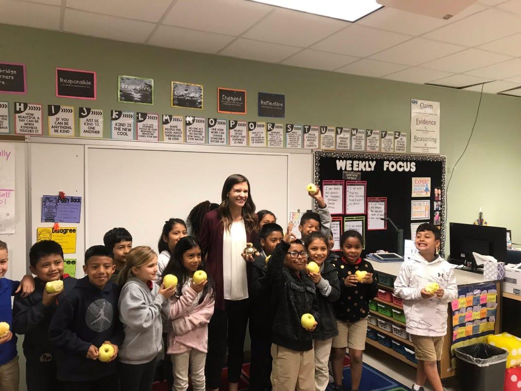 Jill Striz, a third grade teacher at Village Oaks Elementary in Immokalee, receives her Golden Apple award Wednesday, Feb. 13, 2019.