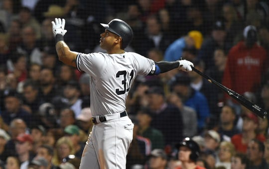 Sep 28, 2018; Boston, MA, USA; New York Yankees center fielder Aaron Hicks (31) hits a three run home run during the fourth inning against the Boston Red Sox at Fenway Park.