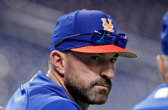 FILE - In this June 30, 2018, file photo, New York Mets manager Mickey Callaway watches batting practice before a baseball game against the Miami Marlins in Miami. Callaway is set to begin his second spring training in charge of the Mets, this time with a revamped roster under a new general manager who expects the team to contend.