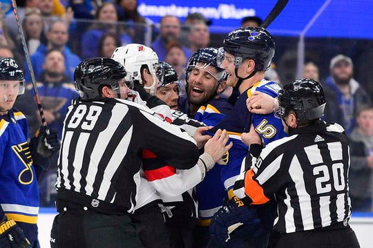 Feb 12, 2019; St. Louis, MO, USA; New Jersey Devils right wing Kurtis Gabriel (39) and St. Louis Blues left wing Pat Maroon (7) and defenseman Colton Parayko (55) are separated by referees as they attempt to fight during the second period at Enterprise Center.