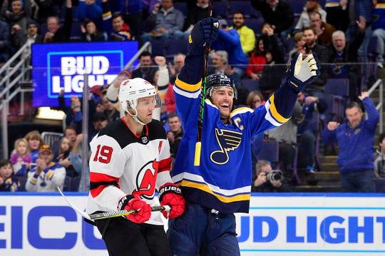Feb 12, 2019; St. Louis, MO, USA; St. Louis Blues defenseman Alex Pietrangelo (27) celebrates after scoring as New Jersey Devils center Travis Zajac (19) skates by during the first period at Enterprise Center.