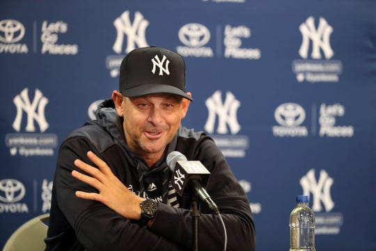 Feb 13, 2019; Tampa, FL, USA; New York Yankees manager Aaron Boone talks with members of the media as pitchers and catchers report for spring training at George M. Steinbrenner Field.