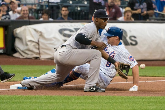 Jun 9, 2018; New York City, NY, USA; New York Mets center fielder Brandon Nimmo (9) slides into third base with a triple as New York Yankees third baseman Miguel Andujar (41) awaits the throw during the first inning of the game at Citi Field.