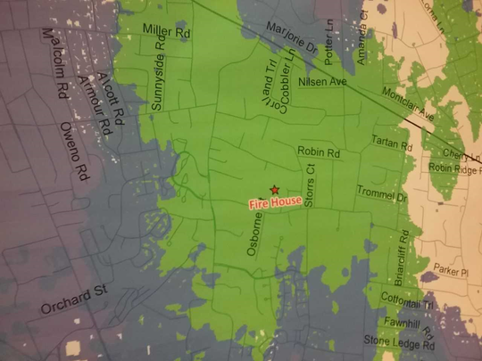 Mahwah's cell phone reception dead zone (in white) and projected area of coverage (in green) generated by a cell phone tower installed at Fire Company 3, according to  a study by AT&T.