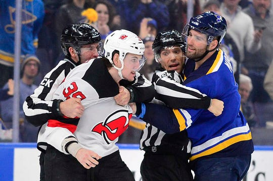 Feb 12, 2019; St. Louis, MO, USA; New Jersey Devils right wing Kurtis Gabriel (39) and St. Louis Blues left wing Pat Maroon (7) are separated by referees as they attempt to fight during the second period at Enterprise Center.