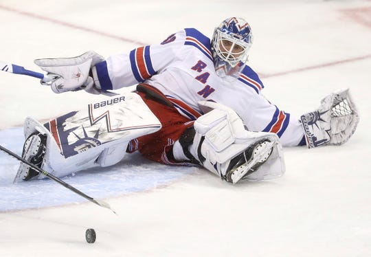New York Rangers goaltender Henrik Lundqvist scrambles after making a save against the Winnipeg Jets during the first period of an NHL hockey game Tuesday, Feb. 12, 2019, in Winnipeg, Manitoba.
