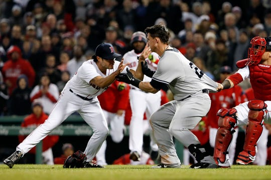 Apr 11, 2018; Boston, MA, USA; New York Yankees first baseman Tyler Austin (26) starts a scrum with Boston Red Sox relief pitcher Joe Kelly (56) during the seventh inning against the Boston Red Sox at Fenway Park.