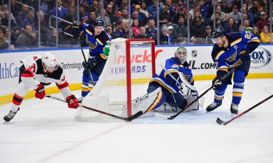 Feb 12, 2019; St. Louis, MO, USA; St. Louis Blues defenseman Alex Pietrangelo (27) and goaltender Jordan Binnington (50) defend the net against New Jersey Devils center Pavel Zacha (37) during the second period at Enterprise Center.