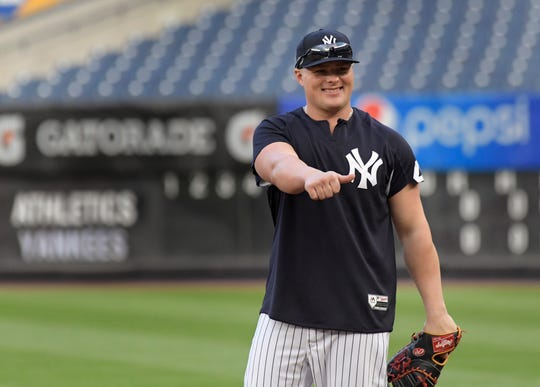 Luke Voit enters spring training as the Yankees first baseman, but he'll be pushed by Greg Bird.