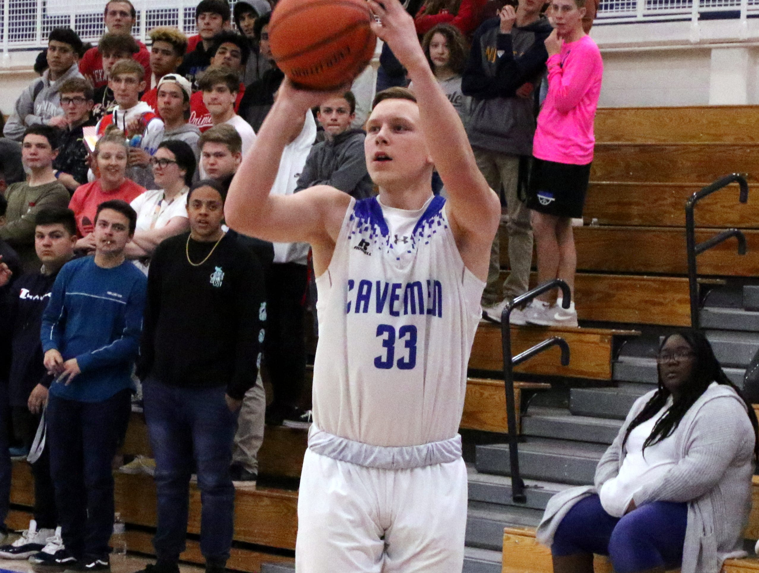 Ayden Parent takes a 3-point shot in the first half of Tuesday's game against Clovis.