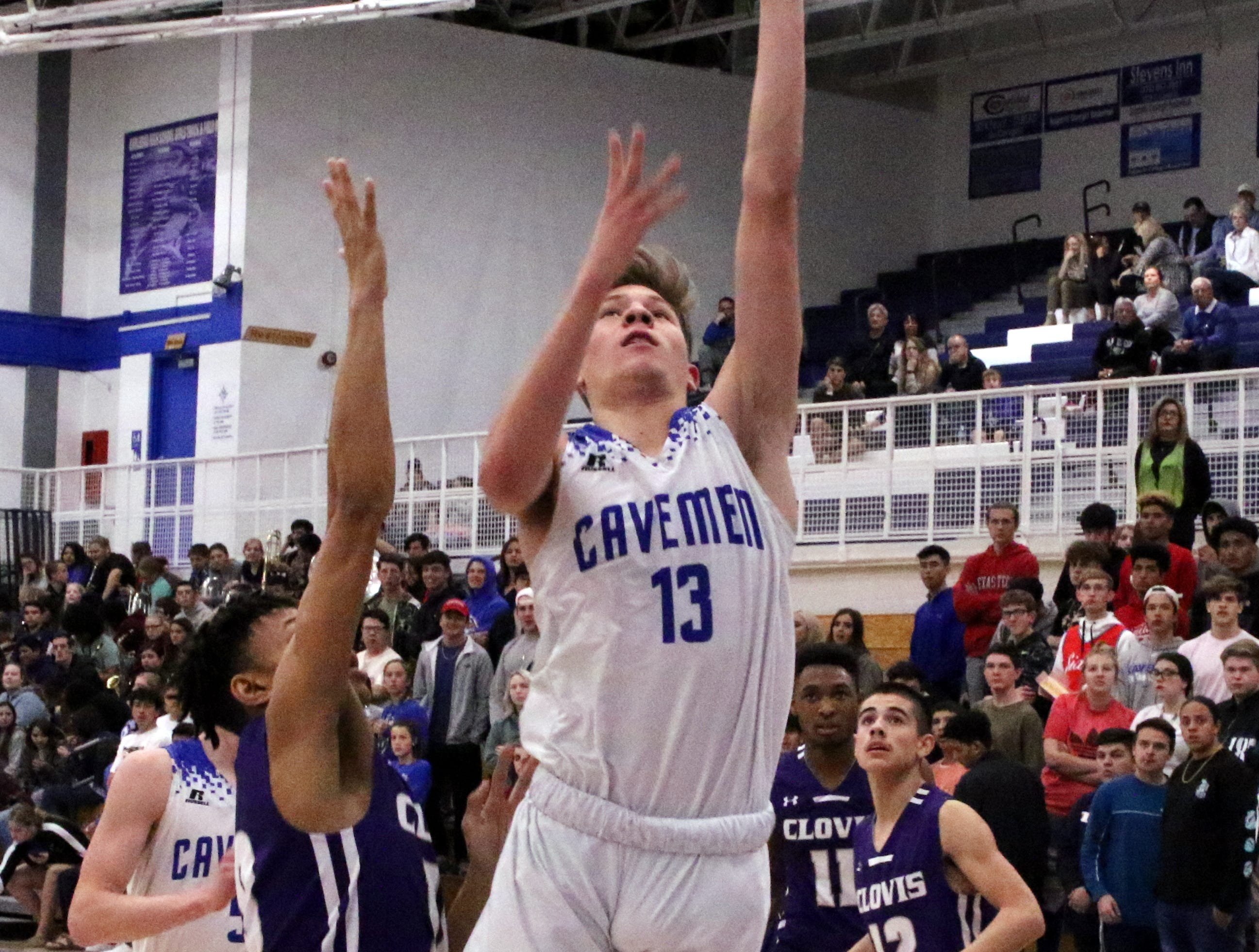 Carlsbad's Stevie Bartlett gets a layup during the first half of Tuesday's game against Clovis. Bartlett finished with three points.