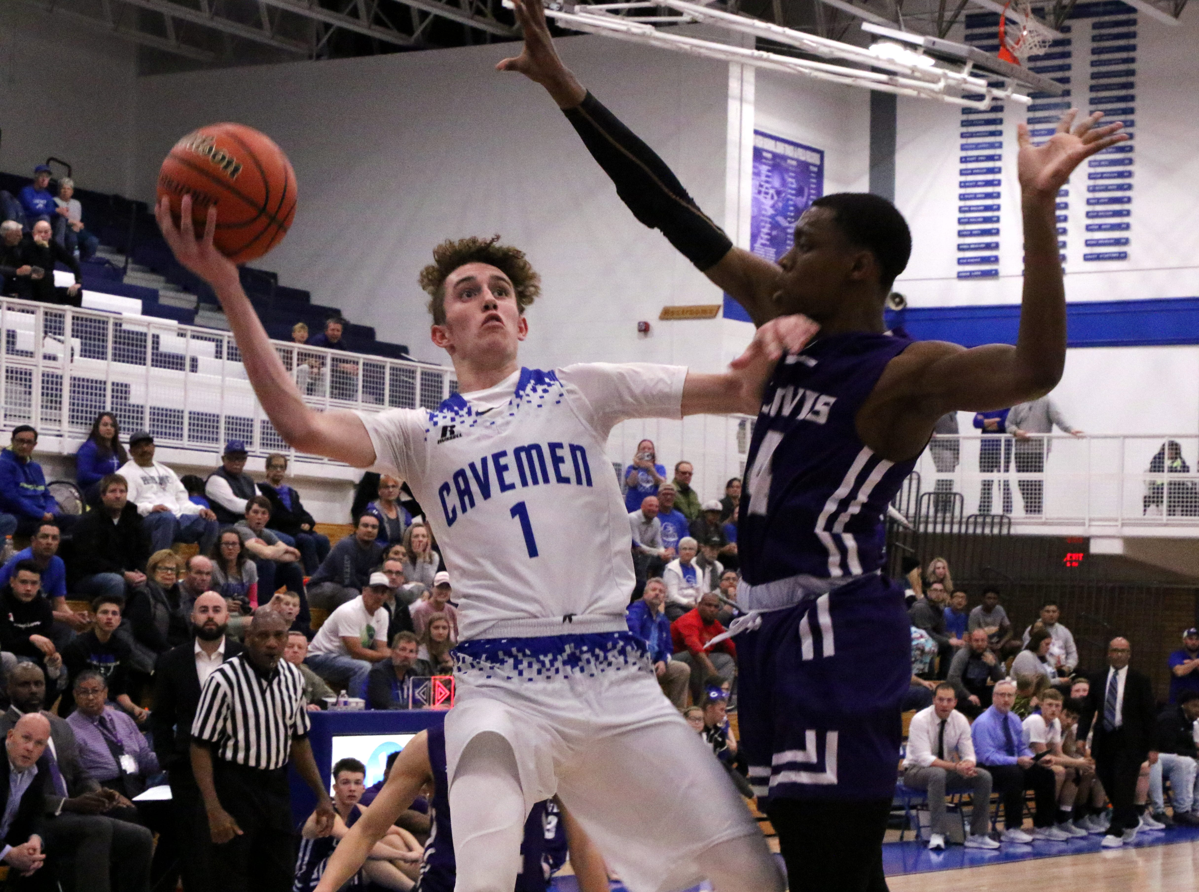 Josh Sillas takes a contested shot during the first half of Tuesday's game against Clovis. He finished with 27 points to lead Carlsbad over Clovis, 45-35.