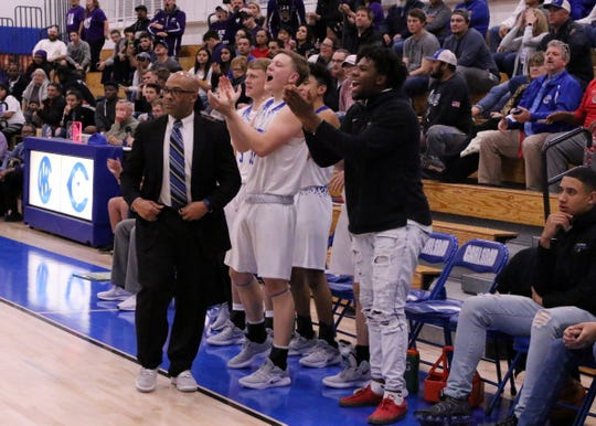 Carlsbad's bench reacts after a made 3-pointer during Tuesday's game against Clovis. Carlsbad got its first district win of the season with a 45-35 win against the Wildcats.