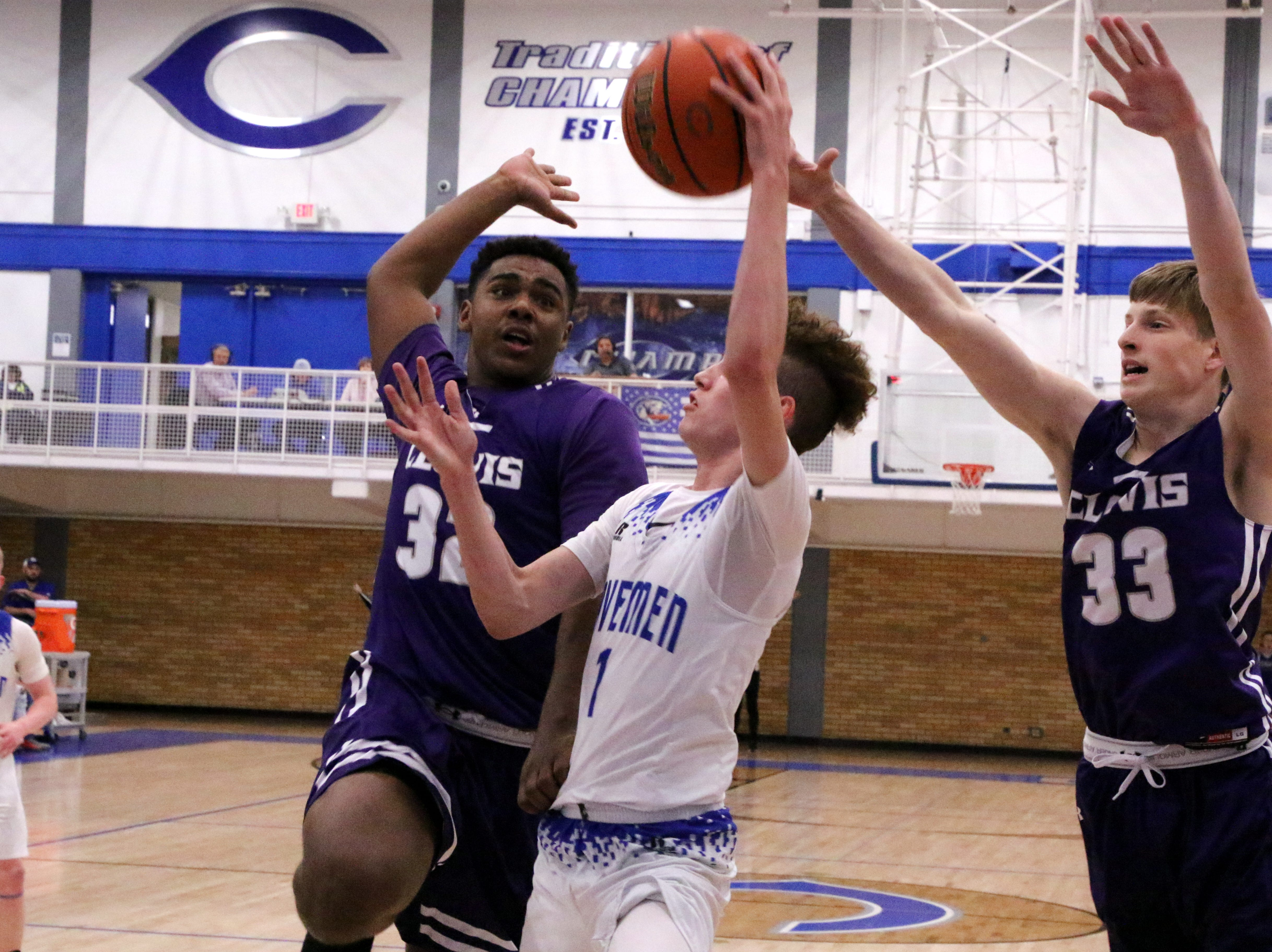 Clovis' Jaden Phillips (32) and Ethan Gershon (33) go for a block on Carlsbad's Josh Sillas during Tuesday's game.