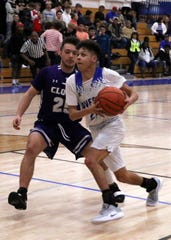 Carlsbad senior Pat Espinoza drives the lane in the final quarter after stealing a pass to put Carlsbad up by 12 points.