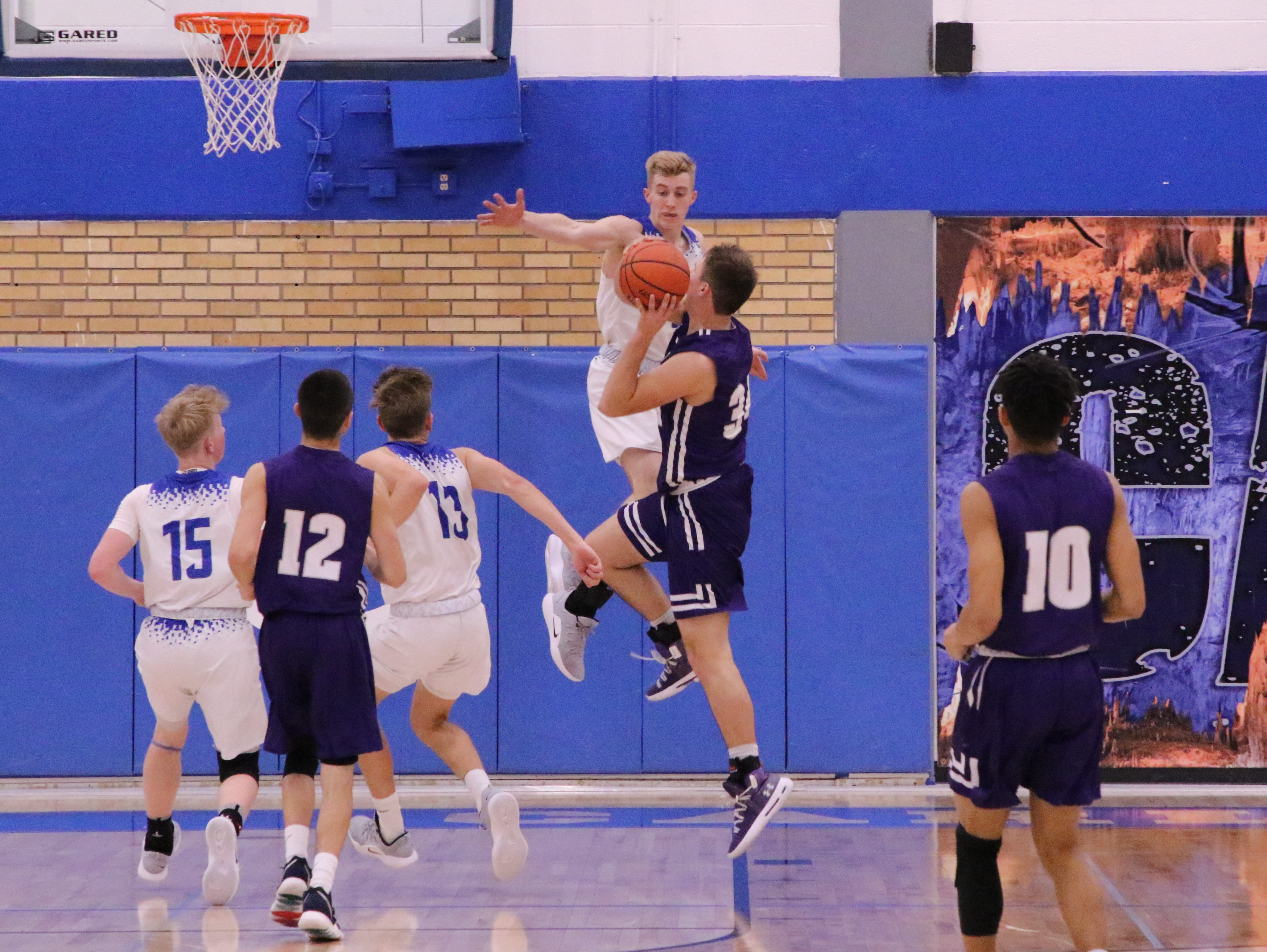 Carlbad's Evan Sullivan goes for a block against Clovis' Bryce Cabeldue during the second half of Tuesday's game.