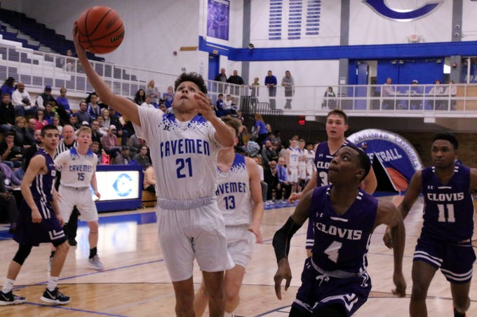 Carlsbad senior Pat Espinoza gets a layup during the first half of Tuesday's game against Clovis. Espinoza finished with 10 points.