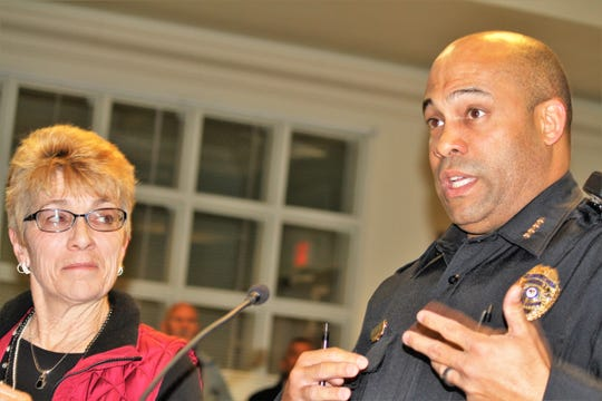 Kitty City President Kathleen Denton and APD Chief Brian Peete speak during Denton's presentation at the Alamogordo City Comission meeting Tuesday night of expanding the community cat program to include a pilot return to field program.