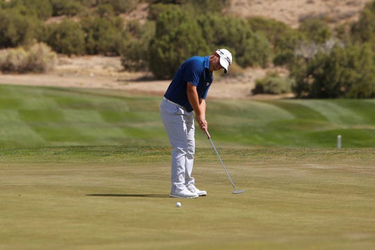 Piedra Vista's Tyler Diehl sinks his ball putting on the 10th green during the Piedra Vista Invitational on Monday, Sept. 24, 2018 at Pinon Hills Golf Course in Farmington. PV opens the Spring 2019 season on April 1 at Riverview Golf Course in Kirtland.