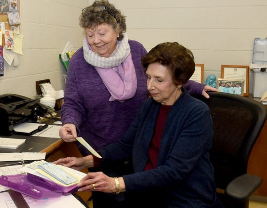 Barbara Fontenot, seated, could probably be in the Guinnes Book of World Records for having the same job for a total of 62 years as office manager-secretary at Opelousas Catholic School. Fontenot began her employment right after high school which means she has been associated with the school for a total of 72 years. Pictured with her is Principal Marty Heintz.