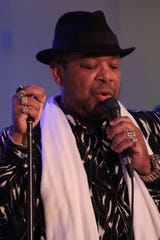 """Barry Minniefield sings """"Amazing Grace"""" at a celebration of life ceremony for Steve Madaio, Palm Desert, Calif., Tuesday, February 13, 2018."""
