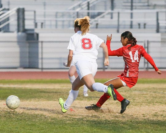 Lizbeth Reyes shoots the ball and scores in the first half for the Rams.