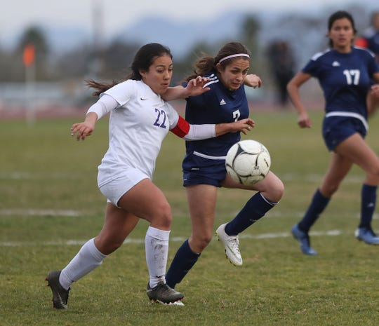 Mariela Orozco, 7, of Desert Hot Springs fights for a loose ball against Vasquez in the CIF playoffs, February 12, 2019.