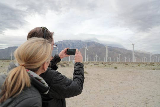 """A couple uses the 4th Wall app to view the virtual reality Desert X installation """"Revolutions"""" by Nancy Baker Cahill on Wednesday, February 13, 2019."""