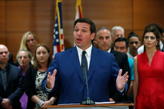 Florida Gov. Ron DeSantis speaks during a news conference, Wednesday, Feb. 13, 2019, in Fort Lauderdale, Fla. DeSantis ordered a statewide grand jury investigation on school safety.