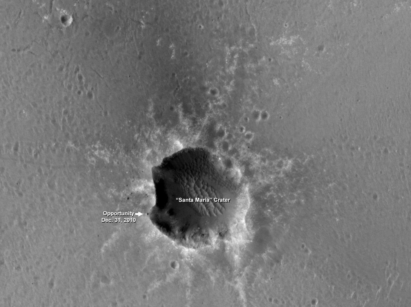 """The High Resolution Imaging Science Experiment (HiRISE) camera on NASA's Mars Reconnaissance Orbiter took this image of the Opportunity rover on the southwest rim of """"Santa Maria"""" crater on New Year's Eve 2010. The camera is operated by the University of Arizona."""