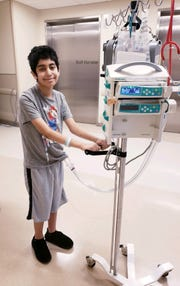 With an artificial heart in place, Gabriel Gonzalez was up, playing video games and walking down the hall. He lived with the device for 10 weeks before receiving a transplant.