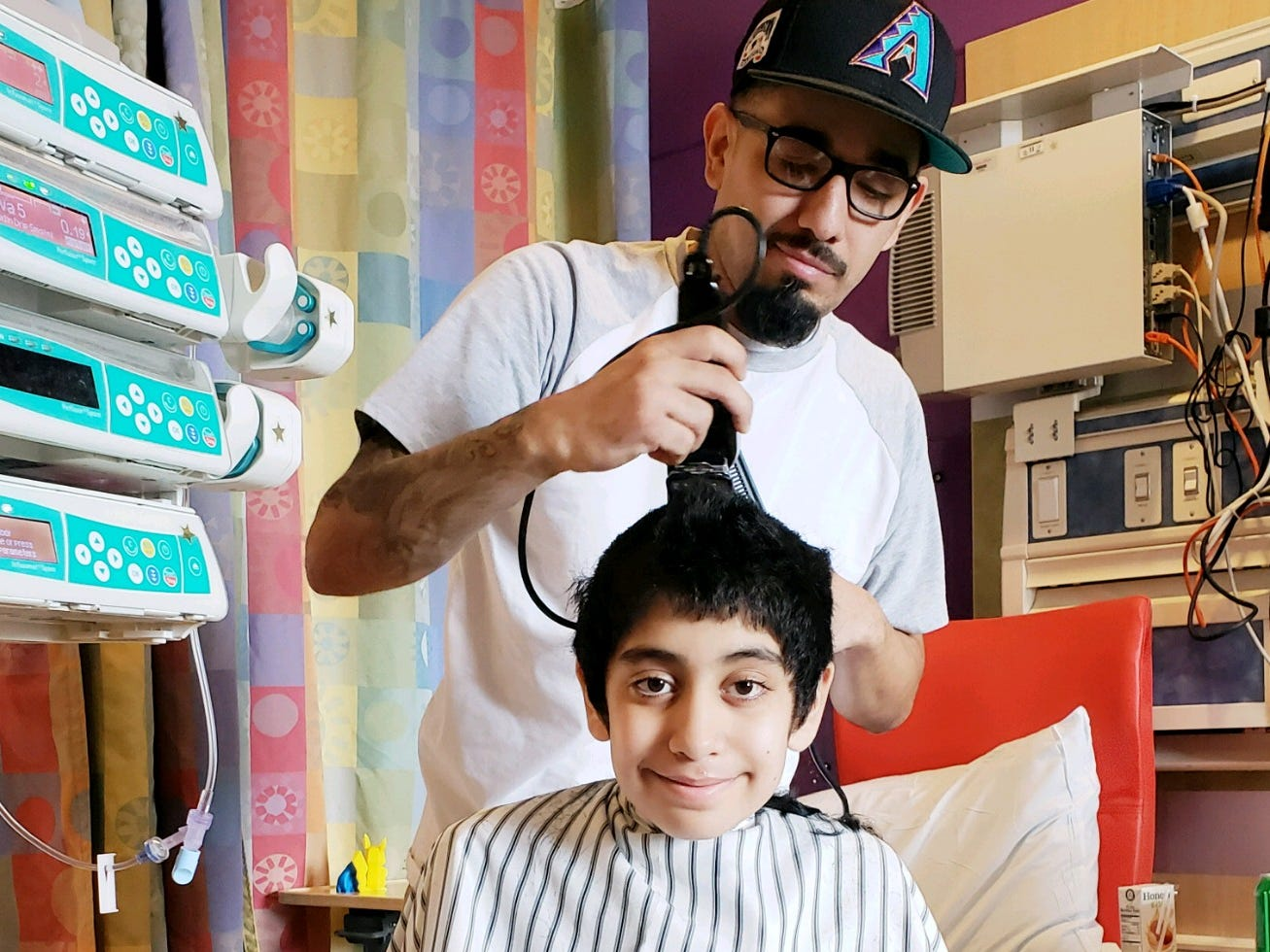 Gabriel Gonzalez was at Phoenix Children's Hospital for almost four months awaiting a heart transplant. His uncle Paul Varela gives him a much-needed haircut.