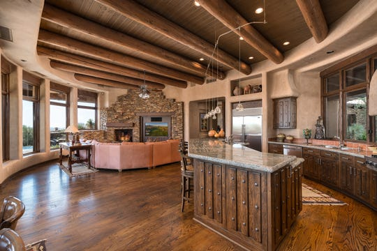 The 6,015-square-foot Scottsdale home purchased by Bruce and Mary Ellen Pindyck includes exposed wood beams and Venetian plaster walls.