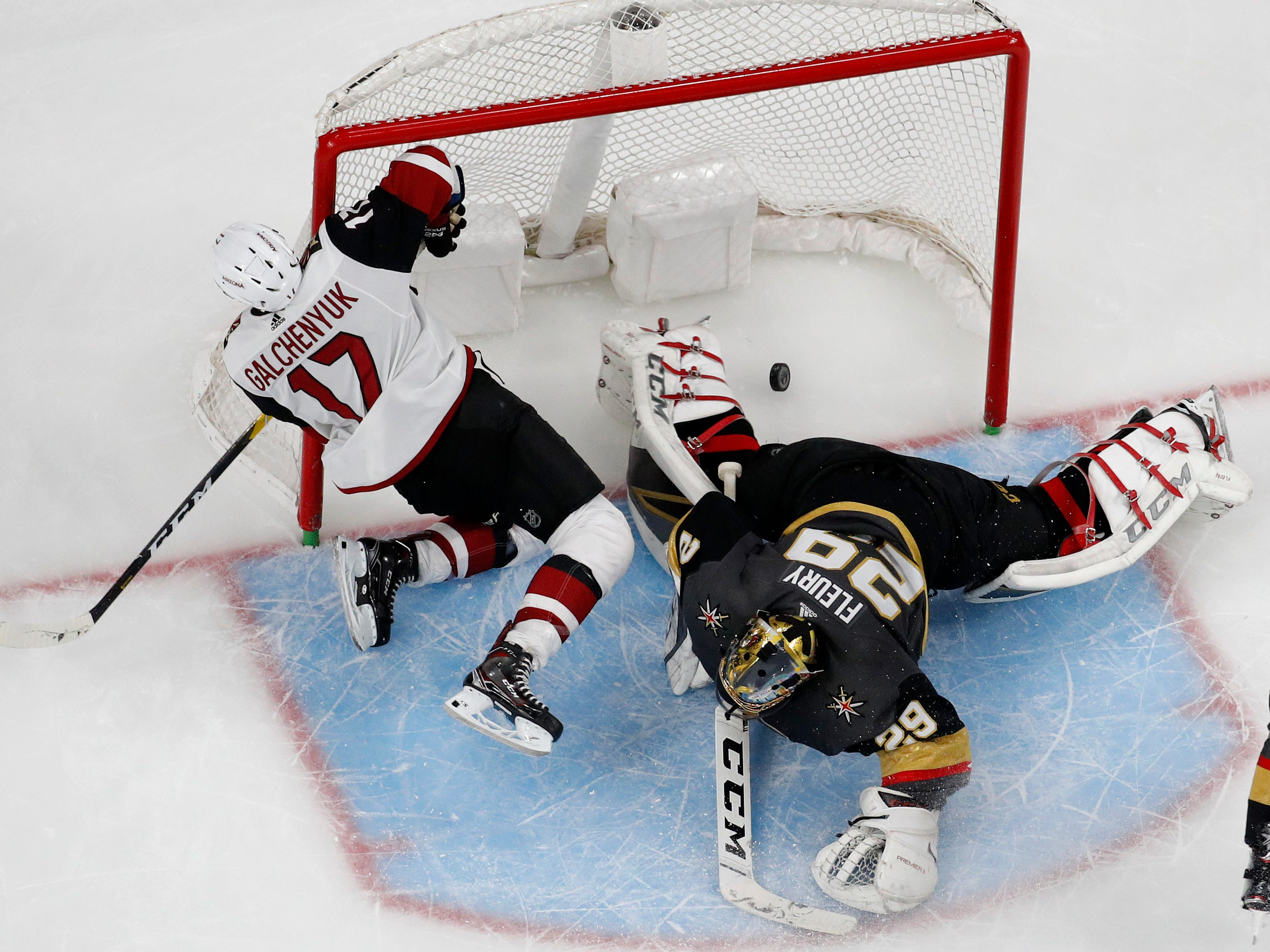 Arizona Coyotes center Alex Galchenyuk (17) slides into the net after scoring against Vegas Golden Knights goaltender Marc-Andre Fleury (29) during the second period of an NHL hockey game Tuesday, Feb. 12, 2019, in Las Vegas. (AP Photo/John Locher)