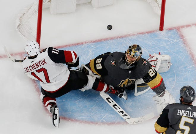 Arizona Coyotes center Alex Galchenyuk (17) scores against Vegas Golden Knights goaltender Marc-Andre Fleury (29) during the second period of an NHL hockey game Tuesday, Feb. 12, 2019, in Las Vegas. (AP Photo/John Locher)