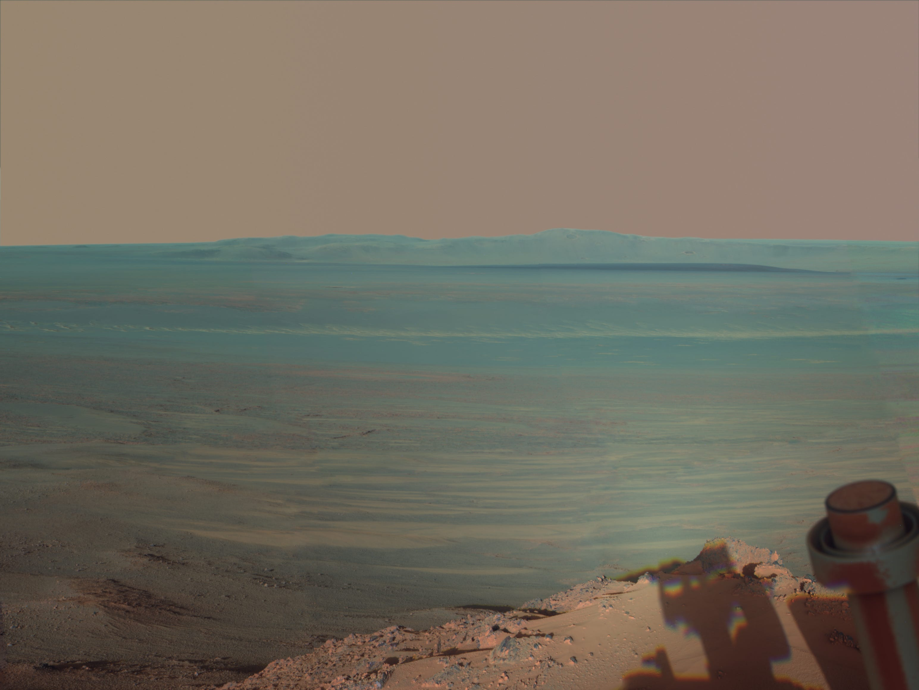 NASA's Mars Rover Opportunity catches its own late-afternoon shadow in this dramatically lit view eastward across Endeavour Crater on Mars. The rover used the panoramic camera (Pancam) to take the photo between 4:30 and 5 p.m. local Mars time on May 22, 2012.