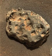 Opportunity found an iron meteorite on Mars, the first meteorite ever identified on another planet. The pitted, basketball-size object is mostly made of iron and nickel. Opportunity used its panoramic camera to take the image on Jan. 6, 2005.