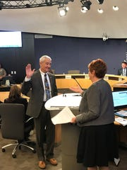 Maricopa County Clerk of the Board of Supervisors Fran McCarroll swears in Jack Sellers. The board appointed Sellers to the open supervisor position on Feb. 13, 2019.