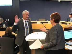 Maricopa County Clerk of the Board of Supervisors Fran McCarroll swears in Jack Sellers. The board appointed Sellers to the open supervisor position on Feb. 13, 2019.