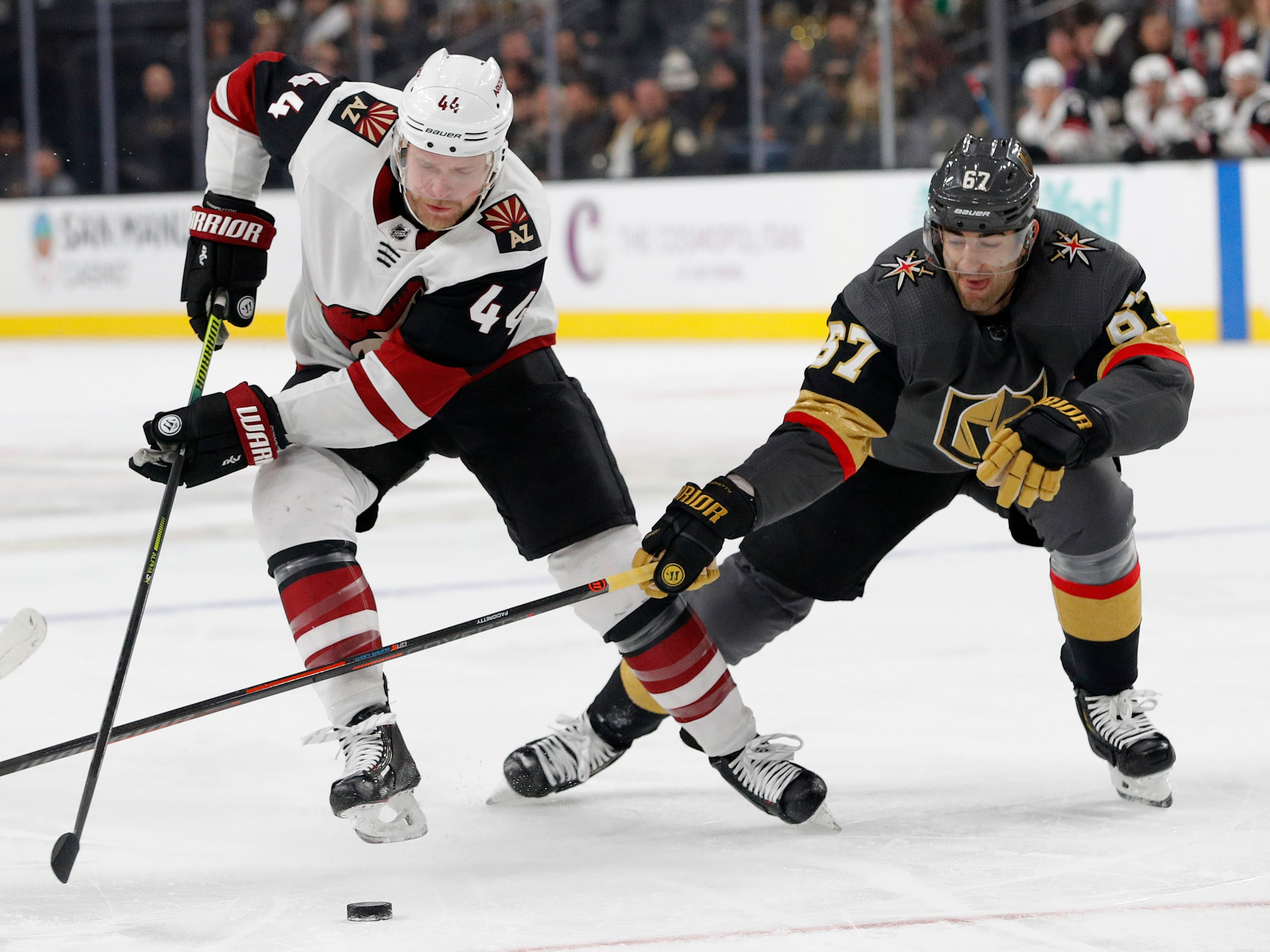 Arizona Coyotes defenseman Kevin Connauton (44) vies for the puck with Vegas Golden Knights left wing Max Pacioretty (67) during the first period of an NHL hockey game Tuesday, Feb. 12, 2019, in Las Vegas. (AP Photo/John Locher)