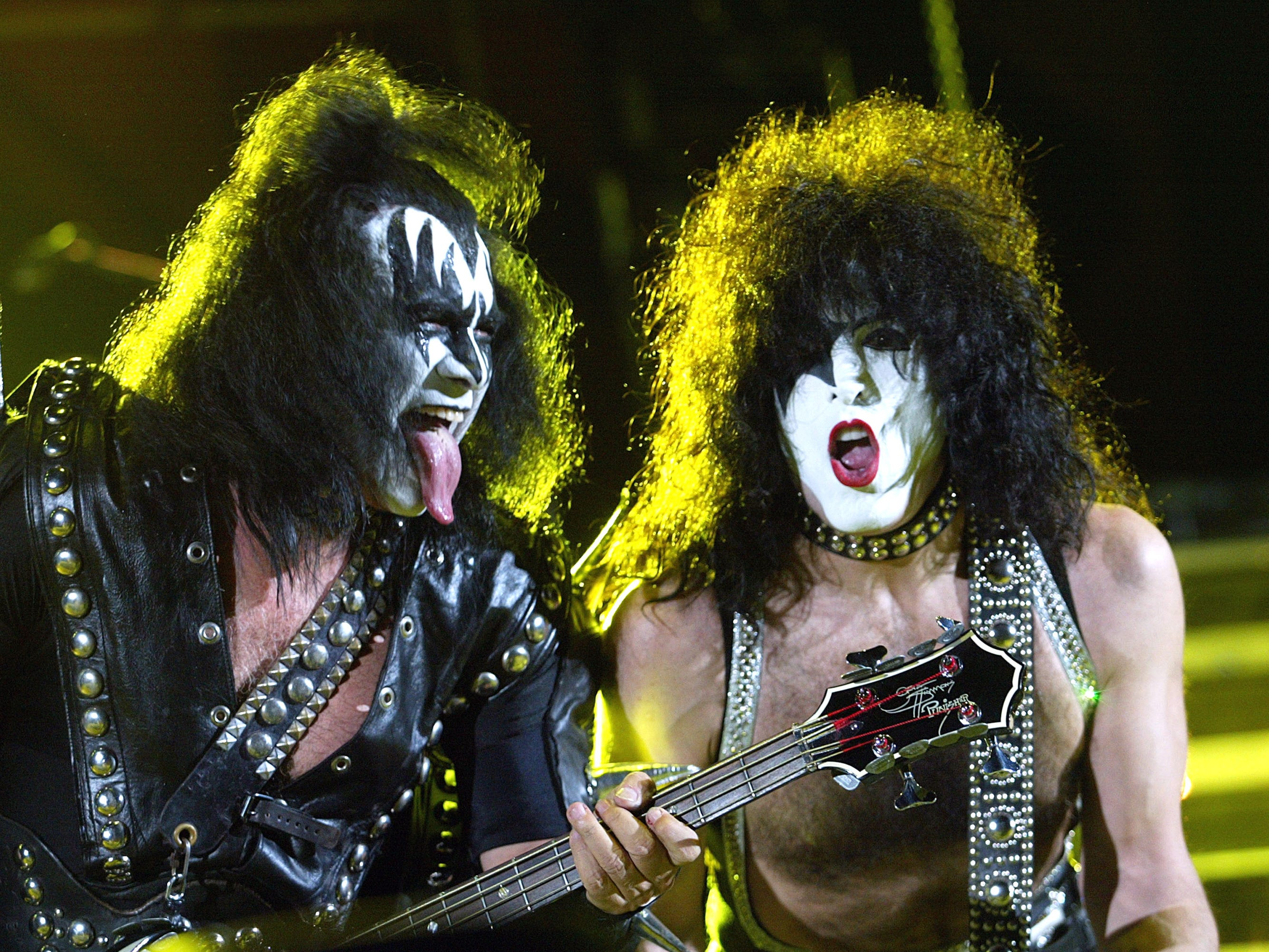 """PASADENA, CA - MAY 17:  KISS, with Gene Simmons (L) and Paul Stanley,  performs at 102.7 KIIS-FM's 6th Annual """"Wango Tango - The Ultimate Reality Show"""" at the Rose Bowl on May 17, 2003 in Pasadena, California. (Photo by Kevin Winter/Getty Images)"""