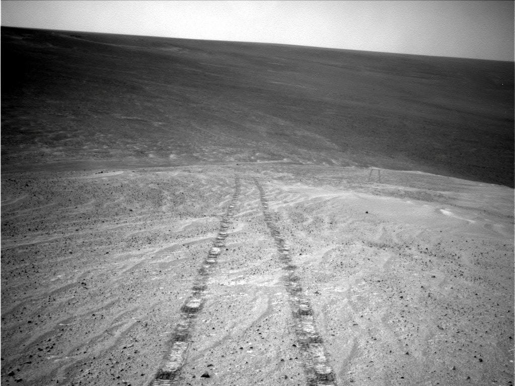 Opportunity caught this image of its tracks after driving uphill on Nov. 12, 2013 on the western edge of Endeavour Crater.