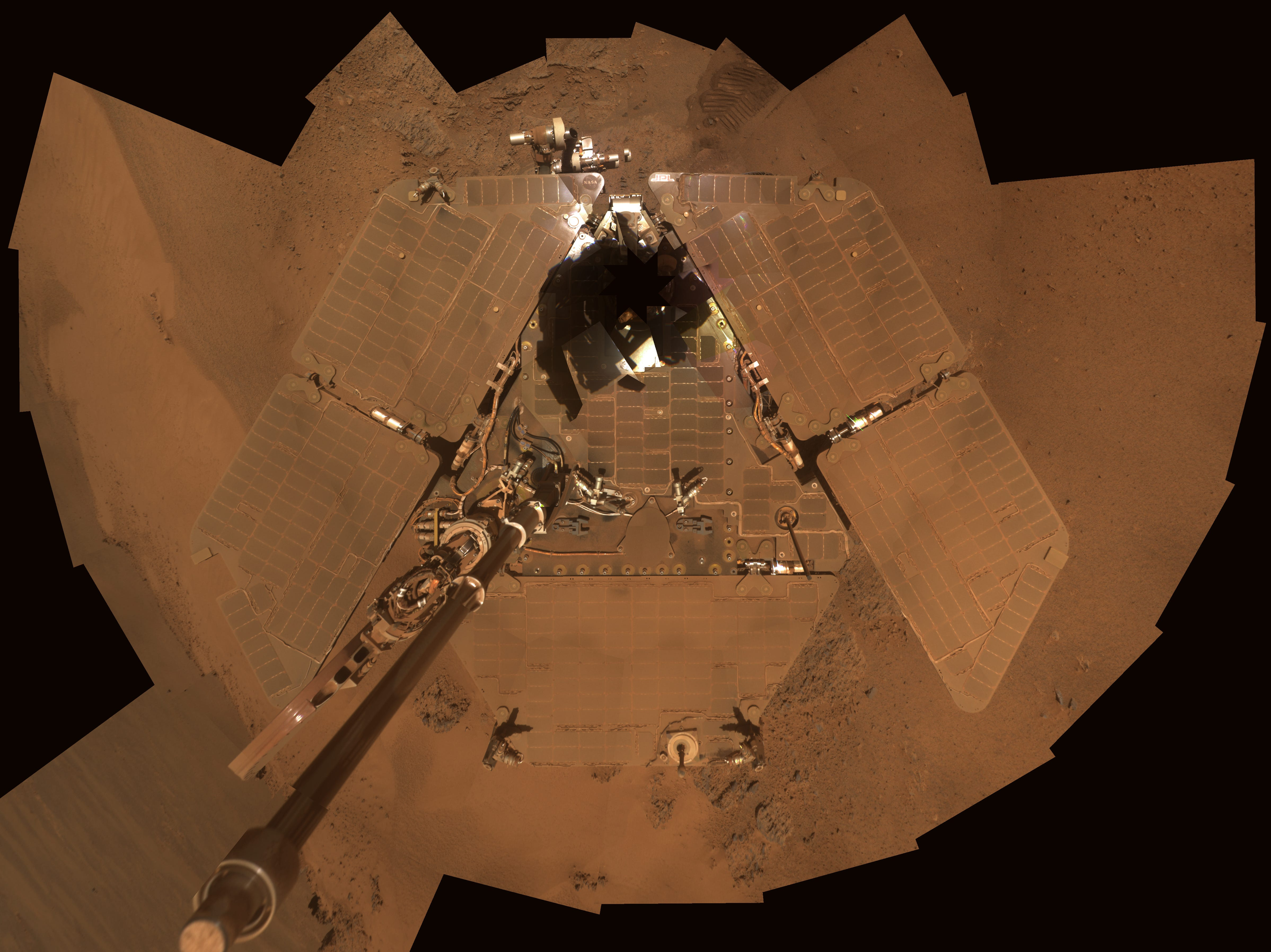 Opportunity took this dusty self-portrait on Feb. 17, 2012. The image shows dust accumulation on the rover's solar panels. Dust reduces the rover's power supply and limits its ability to move about until winter is over or the wind clears the panels.