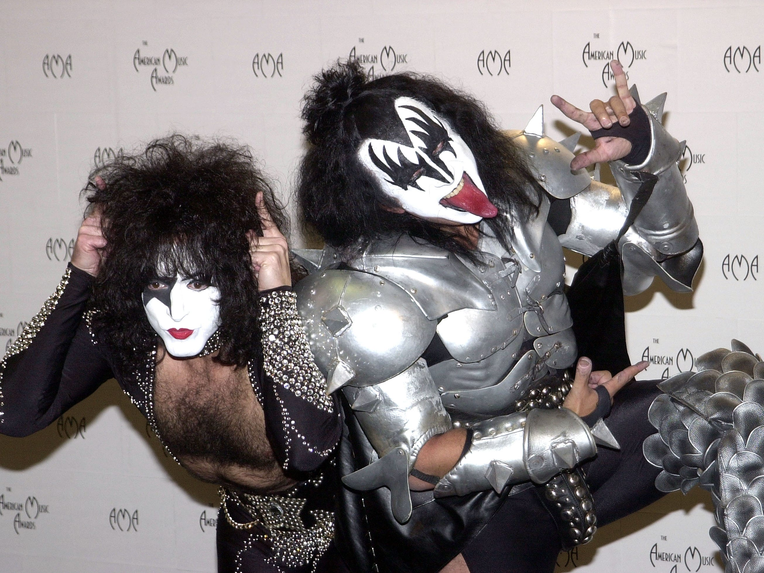 Musicians Paul Stanley and Gene Simmons of Kiss pose backstage during the 29th Annual American Music Awards at the Shrine Auditorium on Jan. 9, 2002 in Los Angeles, CA.