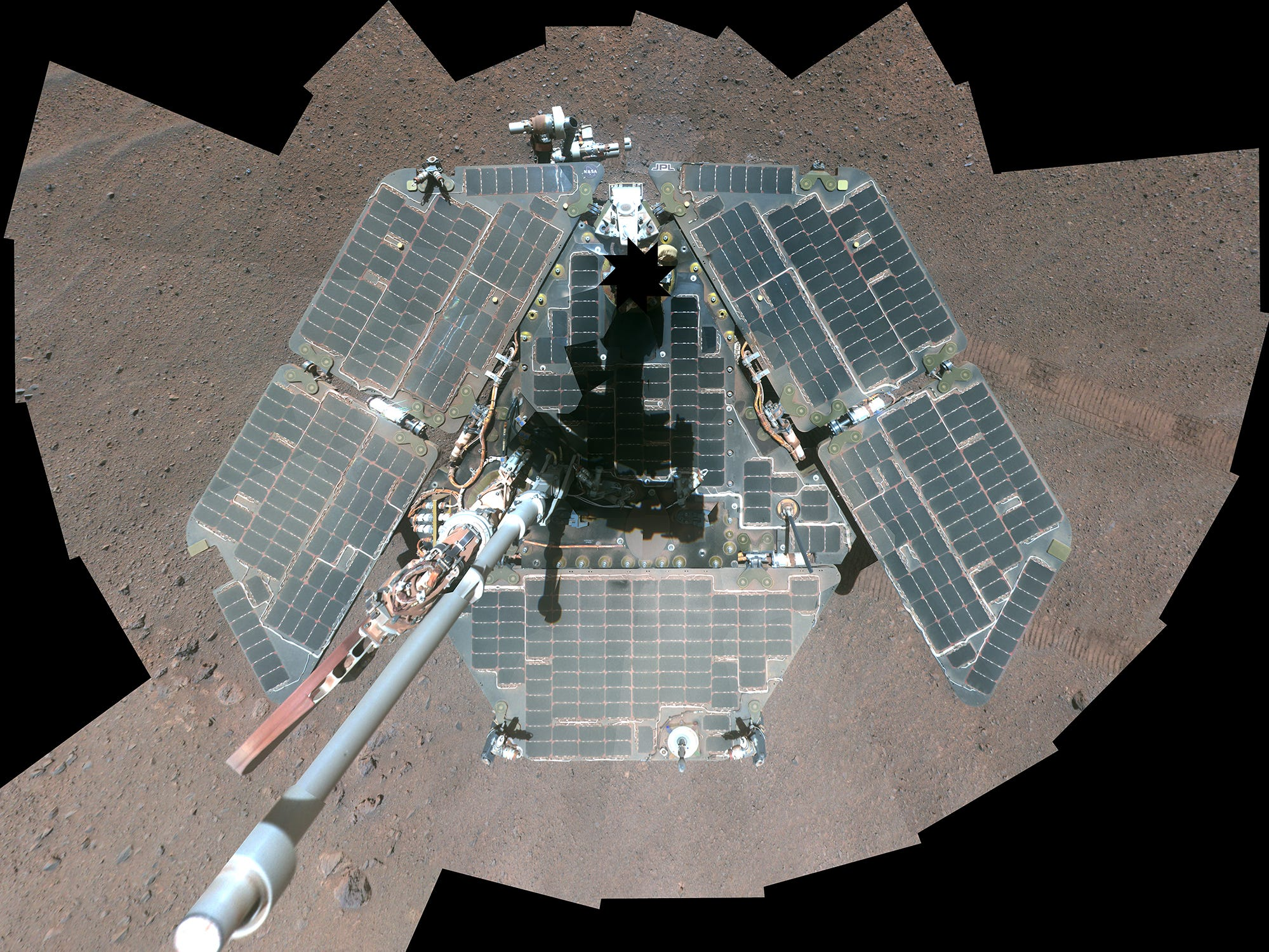 Opportunity took a self portrait on April 17, 2014. The image shows that wind had cleaned much of the dust off the rover's solar panels.