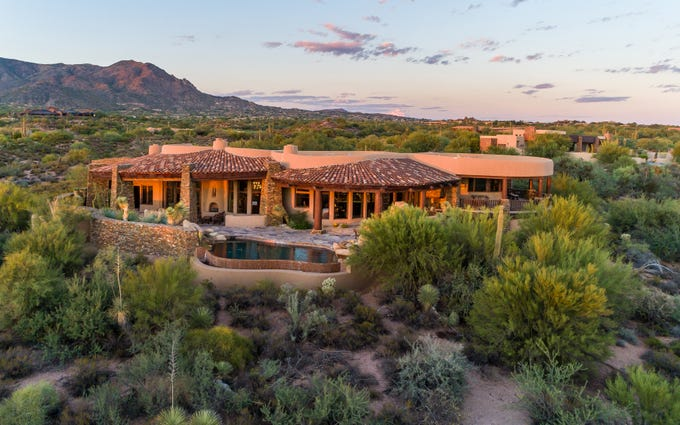 Bruce and Mary Ellen Pindyck paid cash for this mansion in Scottsdale for $2.98M.