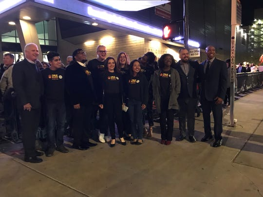"""Arizona State University Public Allies gather for a group picture before """"Becoming: An Intimate Conversation with Michelle Obama"""" at Comerica Theatre, Tuesday, Feb. 12, 2019 in Phoenix."""