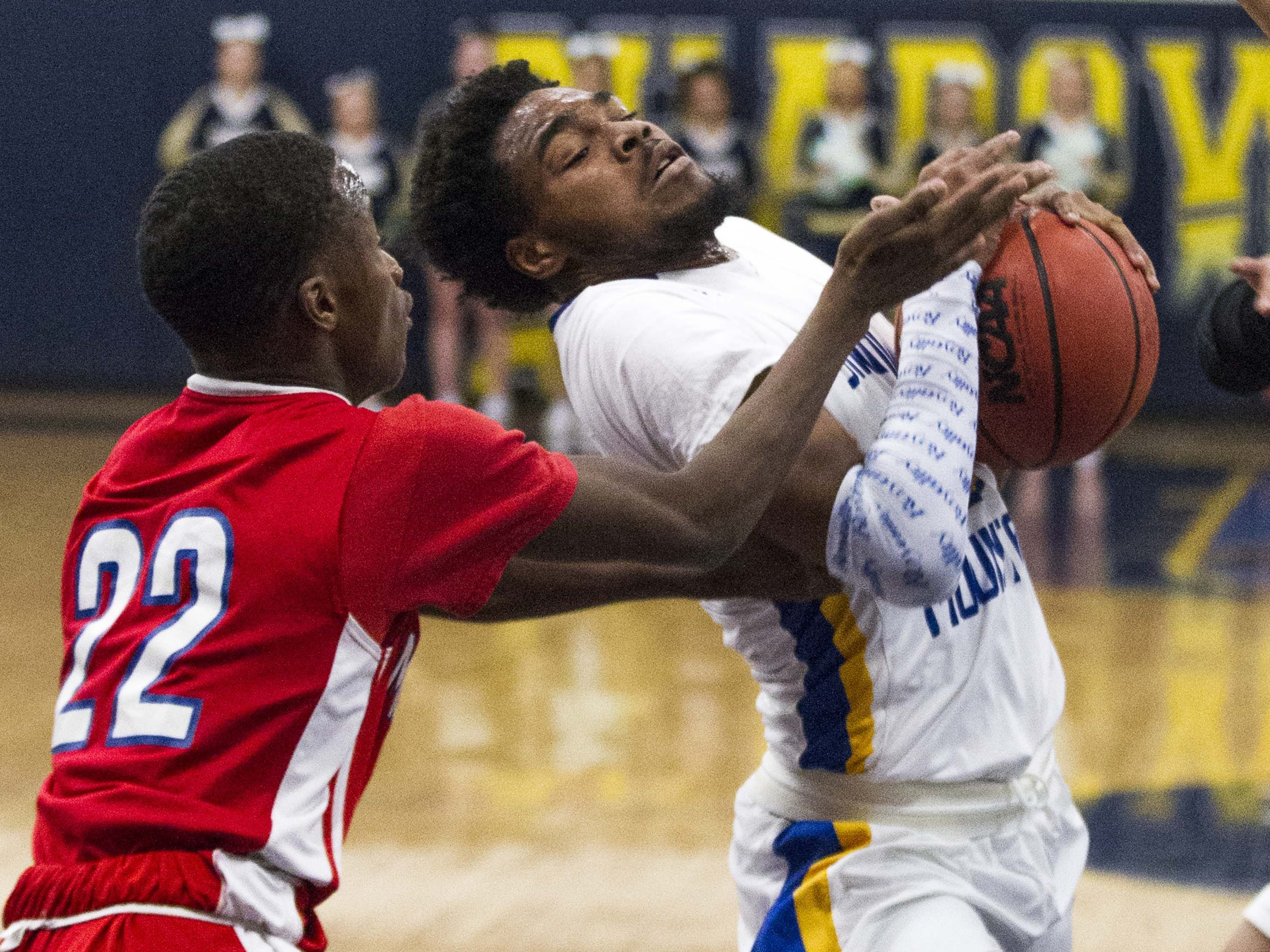 Shadow Mountain's Jalen Williams (0) gets fouled by Moon Valley's Eric Bankhead (22) during the first half of their game in Phoenix, Tuesday, Feb .12,  2019. #azhsfb